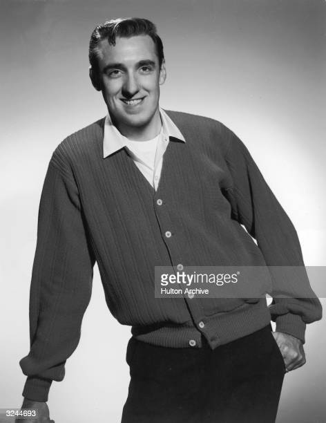 Promotional studio portrait of American actor and singer Jim Nabors best known for playing Gomer Pyle on The Andy Griffith Show wearing a cardigan...