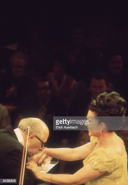 Russianborn cellist and conductor Mstislav Rostropovich kisses the hand of Russian singer Galina Vishnevskaya
