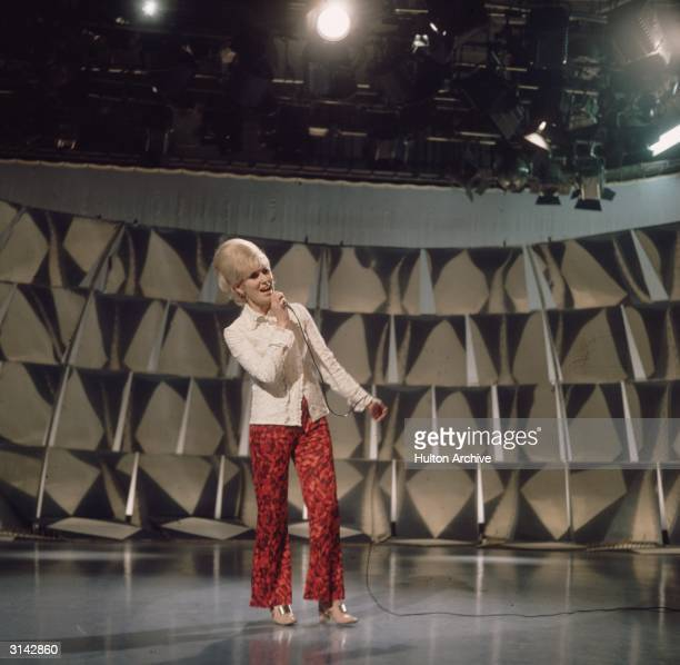 Singer Dusty Springfield rehearsing for a TV show.