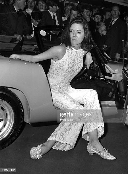 Stage and TV actress Diana Rigg trying out a car at The Motor Show.