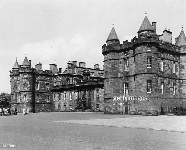 The Palace of Holyroodhouse in Edinburgh, Scotland. The Palace stands at the end of the Royal Mile in Edinburgh and is a popular tourist attraction....