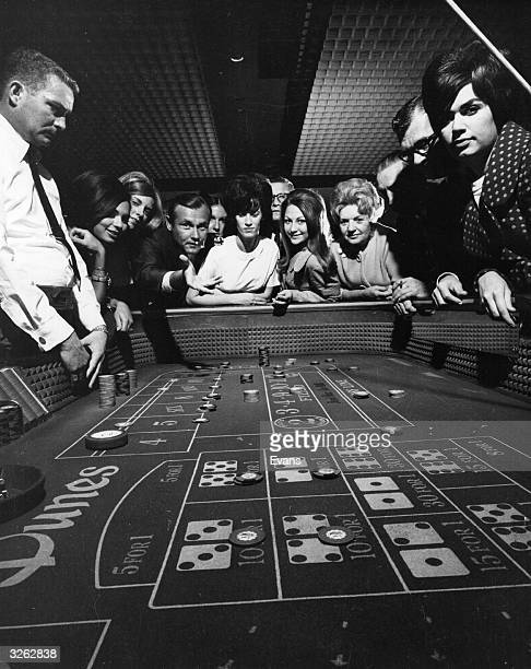 Throwing the dice in the casino at Caesar's Palace Las Vegas