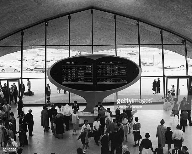 View of an arrival and departure notification board near the entrance of the TWA terminal at Kennedy Airport New York designed by Eero Saarinen