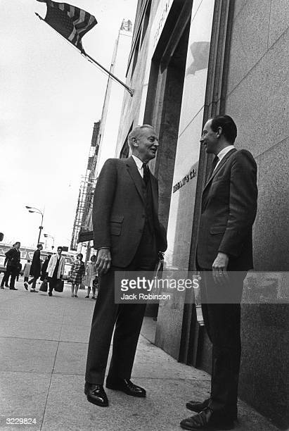 Walter Hoving chairman of Tiffany Co standing with his son Thomas Hoving outside the Tiffany store on Fifth Avenue and 57th Street New York City