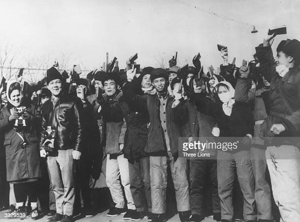 A crowd of young Red Guards brandishing copies of their books of quotations from the writings of Chinese leader Mao Zedong Their mood swings are...