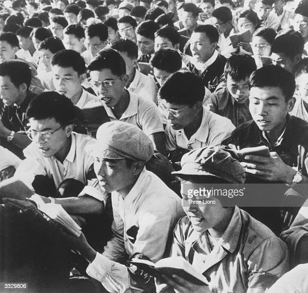 A crowd of young Red Guards reading from the writings of Chinese leader Mao Zedong and chanting in unison