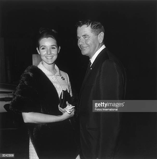 American actor Glenn Ford and his wife, American actor Kathryn Hays, standing at a benefit for Pasadena Playhouse, California. Hays is wearing a dark...