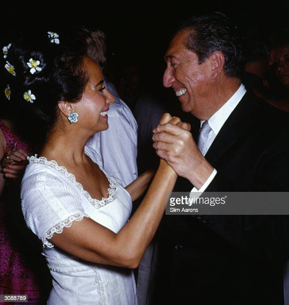 Expresident Don Miguel Aleman dancing with film star Merle Oberon at an Acapulco party A Wonderful Time Slim Aarons