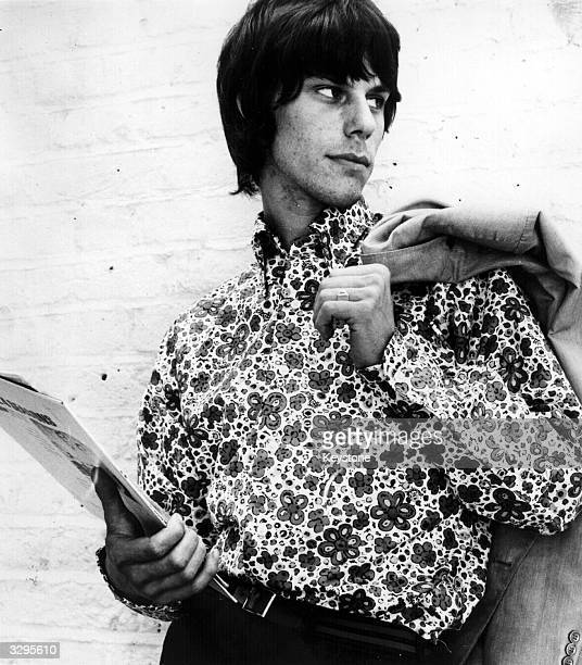 Jeff Beck lead guitarist with British rhythm and blues group The Yardbirds models a flowered shirt by John Stephen