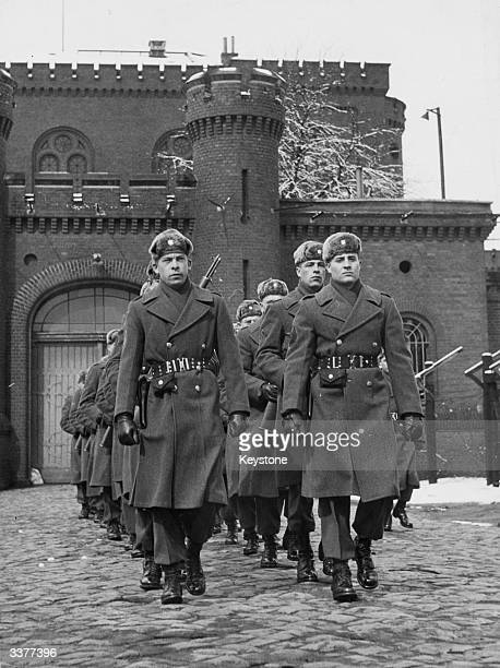 Troops parade in the snow outside Spandau prison in Berlin The 17th century fortress was used to house Nazis convicted of war crimes by the Allies at...