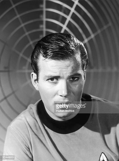 Canadian-born actor William Shatner wears a starship uniform as Captain James T Kirk in a promotional portrait for the science fiction television...