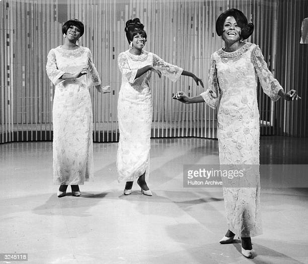 Fulllength view of the pop singing group The Supremes performing on a stage
