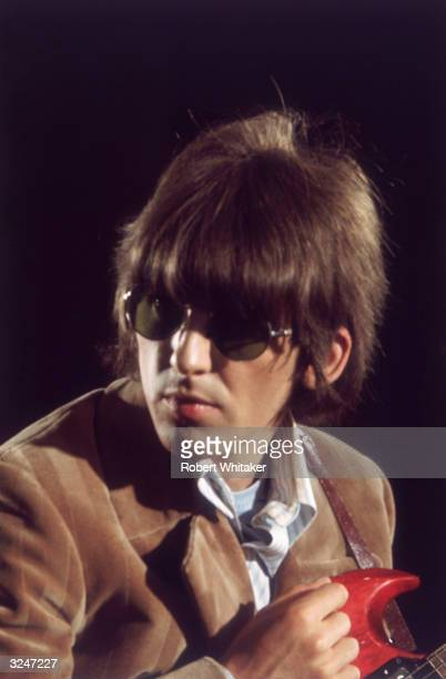 George Harrison of the Beatles holding his guitar during Paperback writer and Rain sessions.