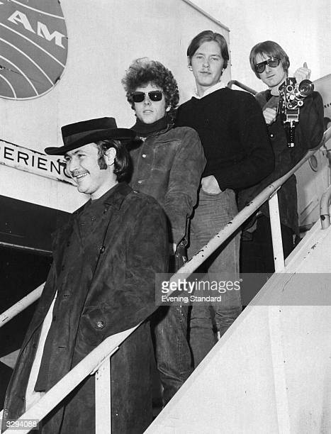 Popular American psychedelic country rock group The Byrds disembark from an aeroplane at London Airport David Crosby Chris Hillman Michael Clarke and...