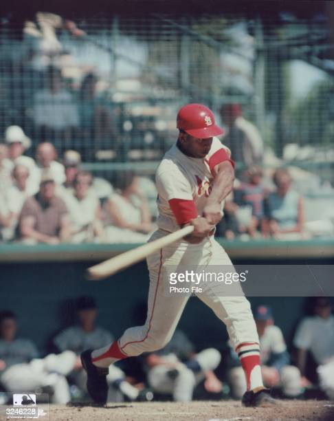 St Louis Cardinals first baseman Orlando Cepeda takes a swing during a game wearing his uniform and helmet He was later inducted into the Baseball...