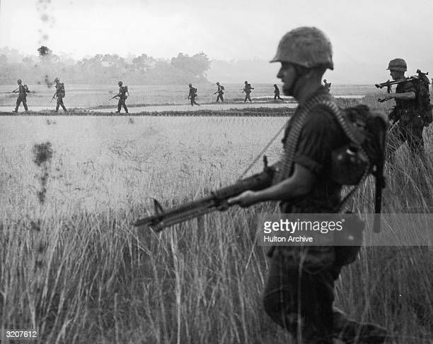 US Marine troops advance across a rice paddy toward enemy positions during operation 'Lien Kit4' near Chu Lai Vietnam Vietnam War late 1960s