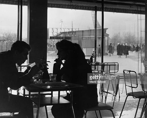 A young couple chatting over a drink at one of Moscow's permanent exhibition centres