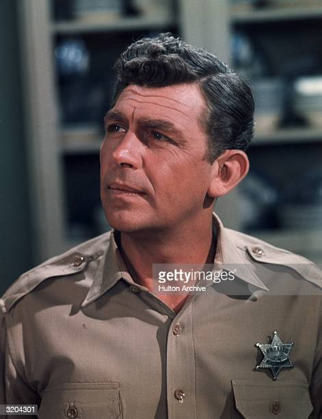 Headshot of American actor Andy Griffith in his uniform as sheriff Andy Taylor on 'The Andy Griffith Show' late 1960s