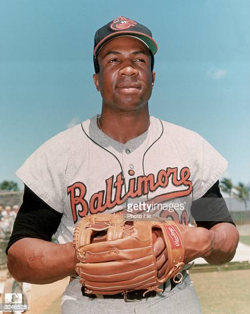 Portrait of American baseball player Frank Robinson first baseman outfielder and slugger for the Baltimore Orioles wearing his uniform with his glove...