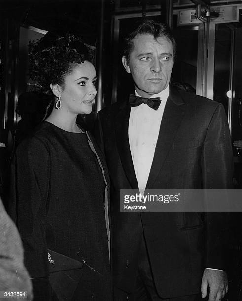 Richard Burton and his wife Elizabeth Taylor arrive at the Rainbow Room at the top of the RCA building for a gala aftertheatre party to celebrate the...