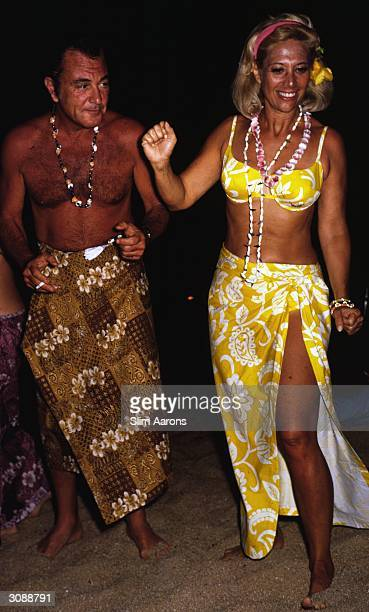 Singers Tony Martin and Dinah Shore enjoying themselves at a beach party in Acapulco A Wonderful Time Slim Aarons