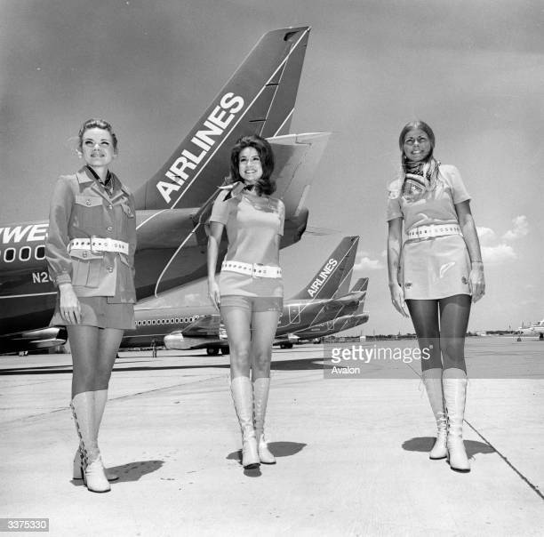Stewardesses on Southwest Airlines in Texas stand in front of planes belonging to the airline
