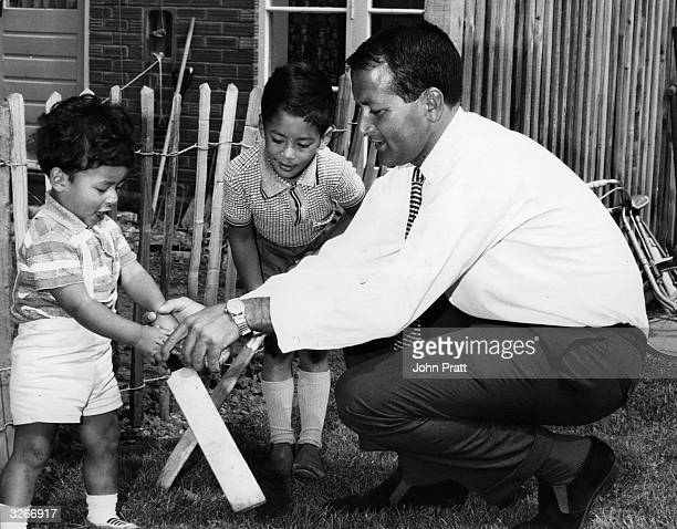 Worcestershire cricketer Basil D'Oliveira plays with his children He left South Africa because of racism but he was likely to lose his place on...