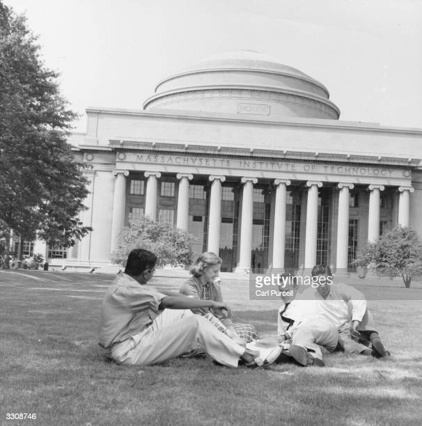 A group of students on the lawn outside the main building of the Massachusetts Institute of Technology Boston