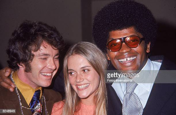 American actors Michael Cole Peggy Lipton and Clarence Williams III all cast members from the television program 'The Mod Squad' smile while embracing