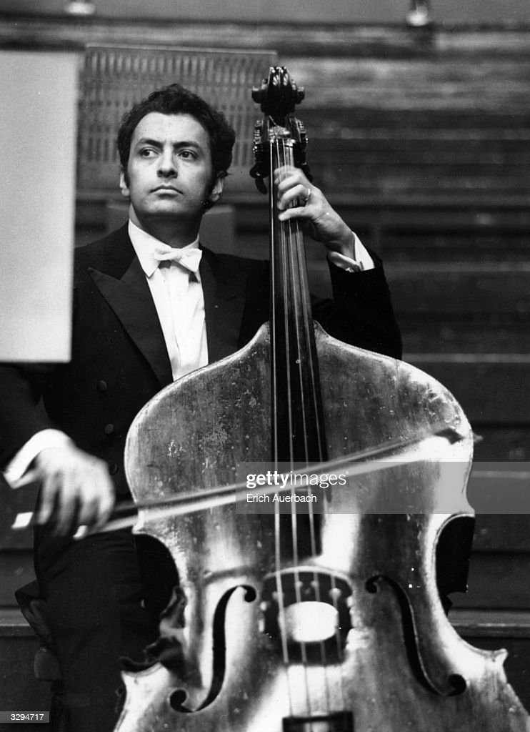 Conductor Zubin Mehta (1936 - ) with double bass.