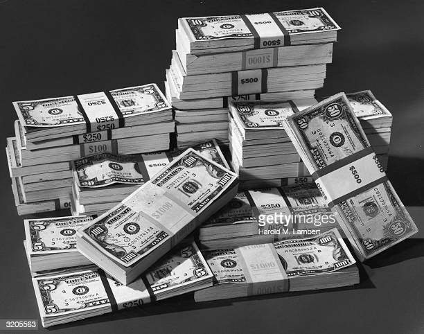 Stilllife of bundles of American paper currency The bundles include five ten twenty and fifty dollar bills