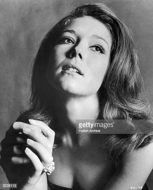 Studio portrait of British actor Diana Rigg clasping her hands and looking up She was appearing in director Peter Hunt's film 'On Her Majesty's...