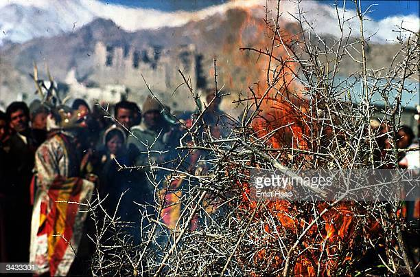 A crowd watching the ritual burning of the 'storma' during the annual Leh Dosmoche ceremony in the remote district of Ladakh in northern India...