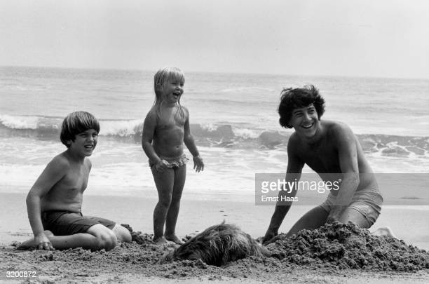 American actor Dustin Hoffman enjoying a day at the beach with his children.
