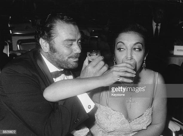 American actor Ernest Borgnine and his wife Katy Jurado toasting each other during the gala after the world premiere of the Italian film 'King Of...