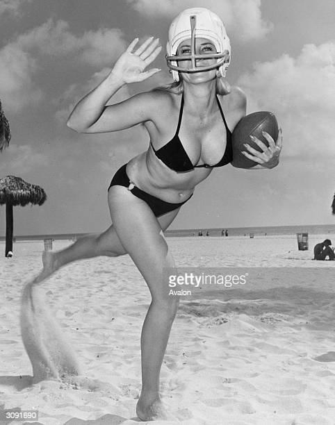 American football rugby fan Hedy Prescott indulges in a little recreational training training at Miami Beach in Florida