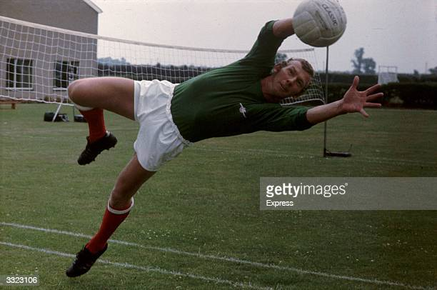 Arsenal goalkeeper Bob Wilson demonstrates his skills during a training session