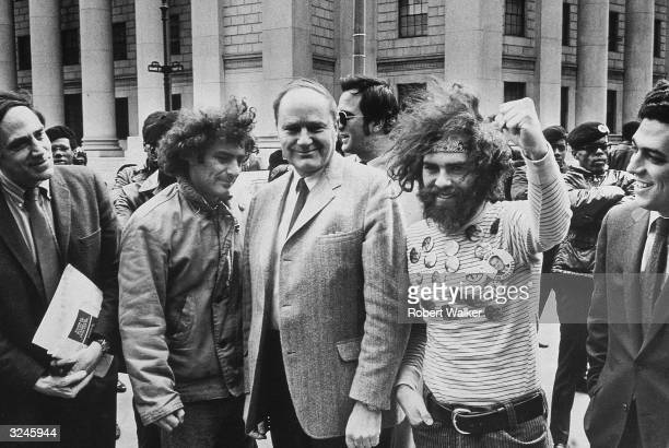 Attorney William Kunstler with members of the Chicago Seven left to right radical activists Abbie Hoffman David Dellinger and Jerry Rubin standing...