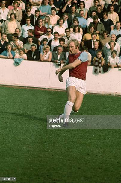 Bobby Moore in action for West Ham United