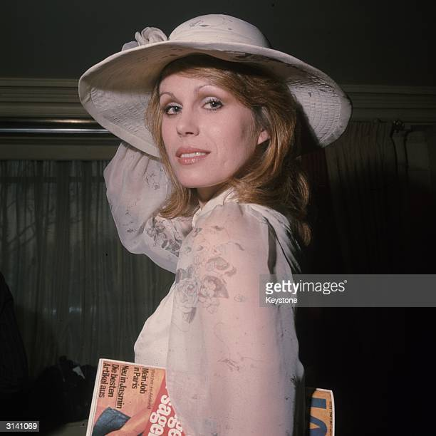 British model and actress Joanna Lumley star of the TV series 'The New Avengers' wearing a summery blouse and hat