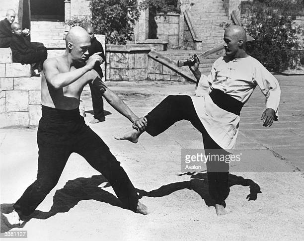 David Carradine practising the oriental art of Kung Fu on a studio lot in Hollywood
