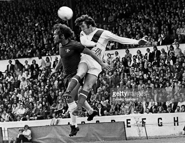 David Webb of Chelsea and a Manchester City player battle it out for control of a high ball