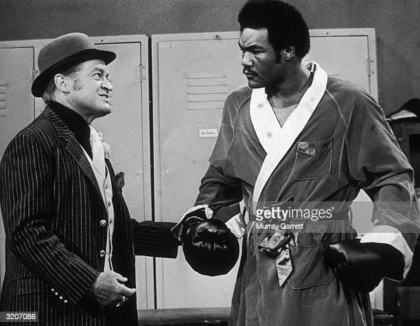 EXCLUSIVE Britishborn comedian and actor Bob Hope jokes with American boxer George Foreman in a lockerroom skit from Hope's television show Los...