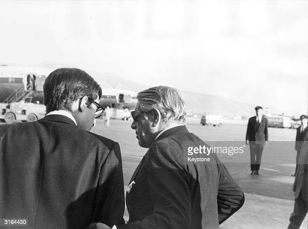 Greek shipping magnate Aristotle Onassis chats with his son Alexander at Athens Airport
