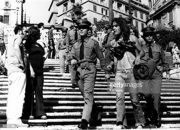 Italian police arresting hippies in the Spanish Square in Rome