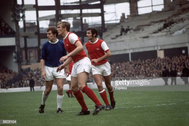 Joe Royle of Everton with Arsenal's John Roberts and Frank McLintock