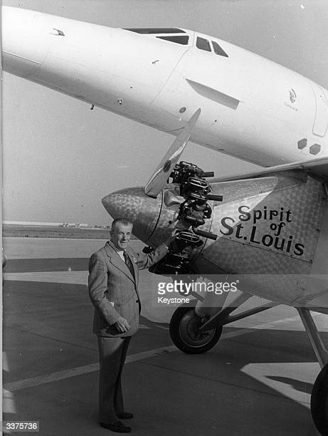 Mechanic Fernand Sarrazin who in 1927 welcomed the Spirit of St Louis after its flight from New York to Paris standing with a replica of the plane...