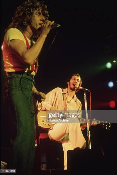 Roger Daltrey and Pete Townshend of The Who playing in concert.