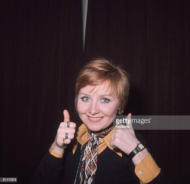 Scottish singer and actress Lulu who rose to stardom in 1964 with her British Top Ten hit 'Shout' gives a cheeky thumbs up