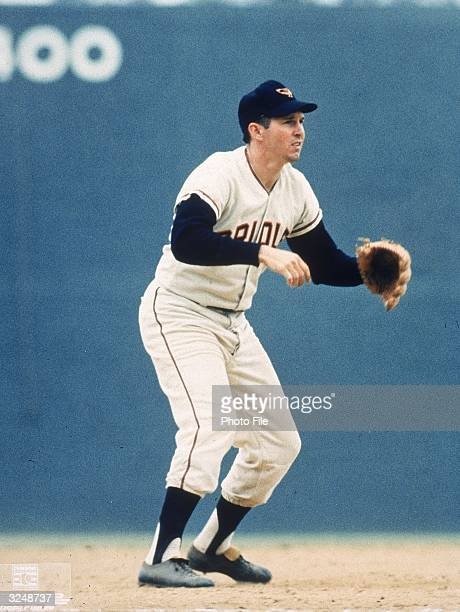 Third baseman Brooks Robinson of the Baltimore Orioles anticipates a catch during a game Robinson played for the Orioles most of his career from...